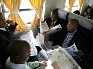 Africa-businessmen-on-train